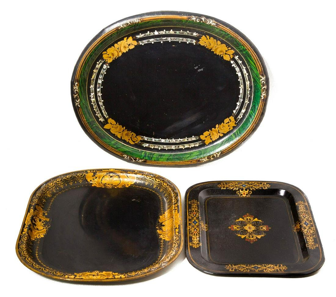 Three decorated tin trays, with golden and pearl