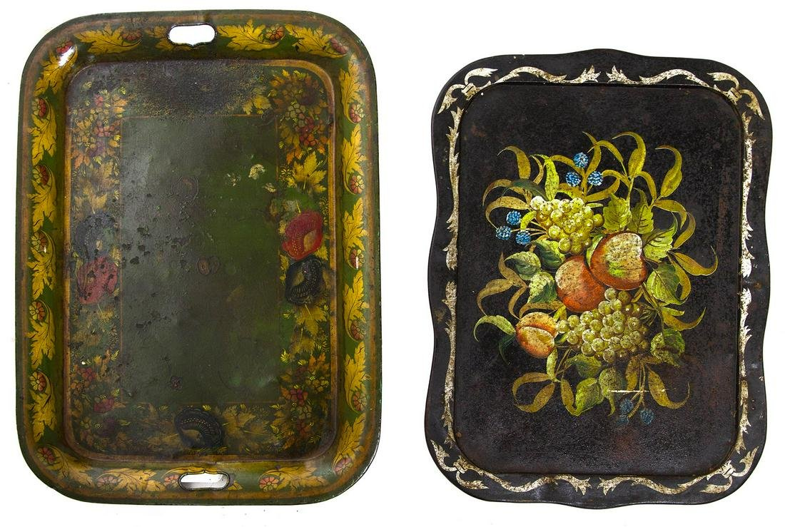 Pair of decorated iron trays. Cm 61 e cm 55