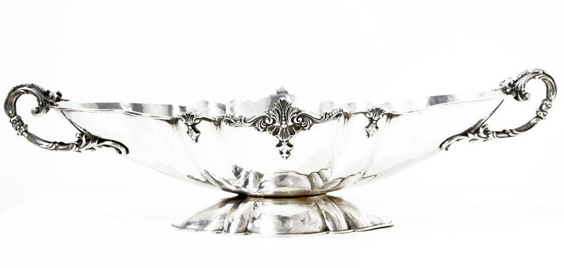 Silver centerpiece, early 1900s. Kg 1,146. Cm 12 x50