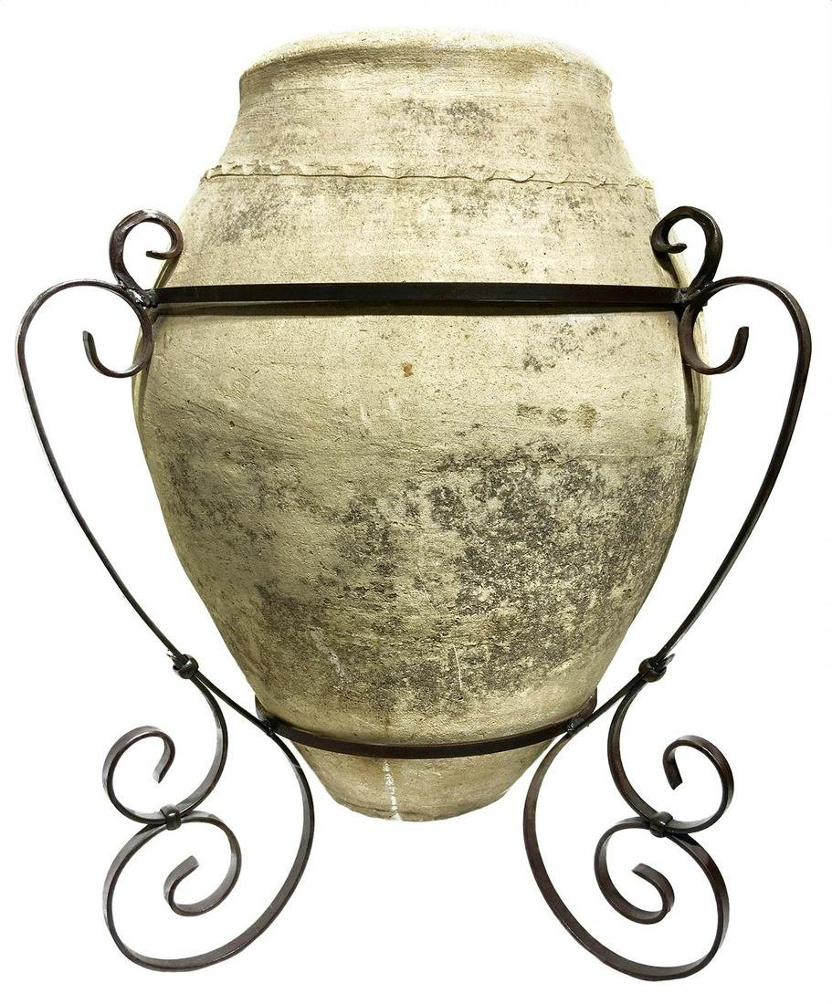 Backed clay jug, 18th century, Sicily. Metal stand