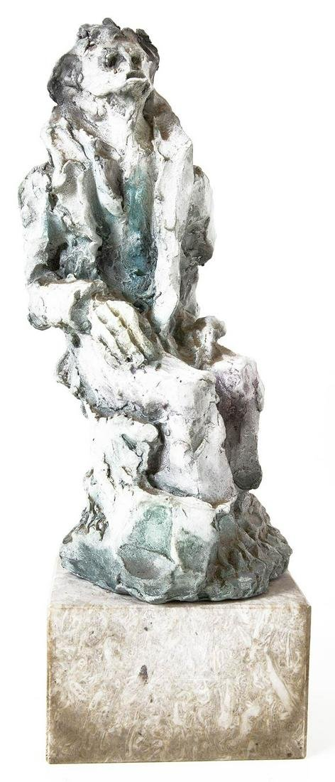 Baked clay sculpture represents a man sitting . Signed