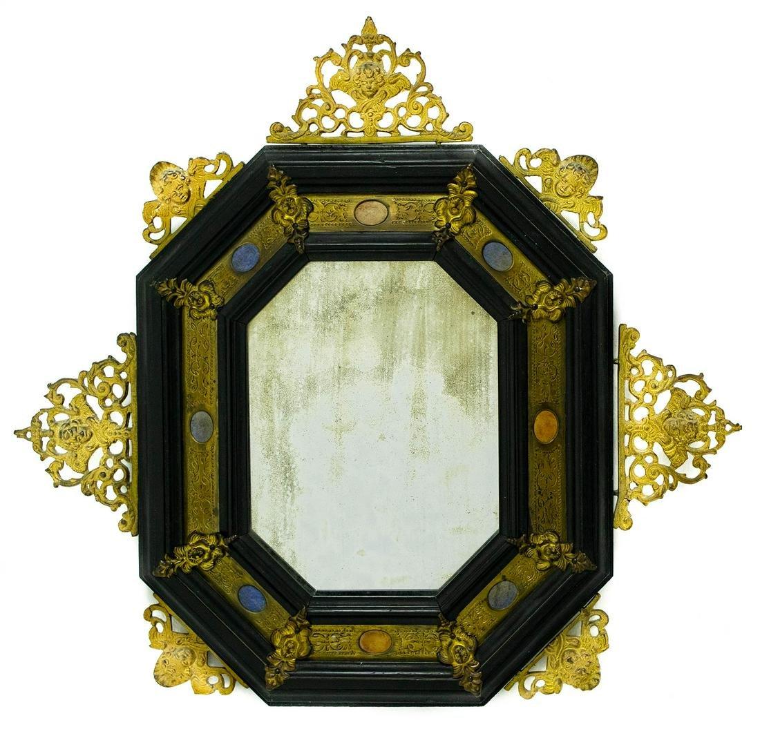 Octagonal ebonized wooden mirror with golden bronzes