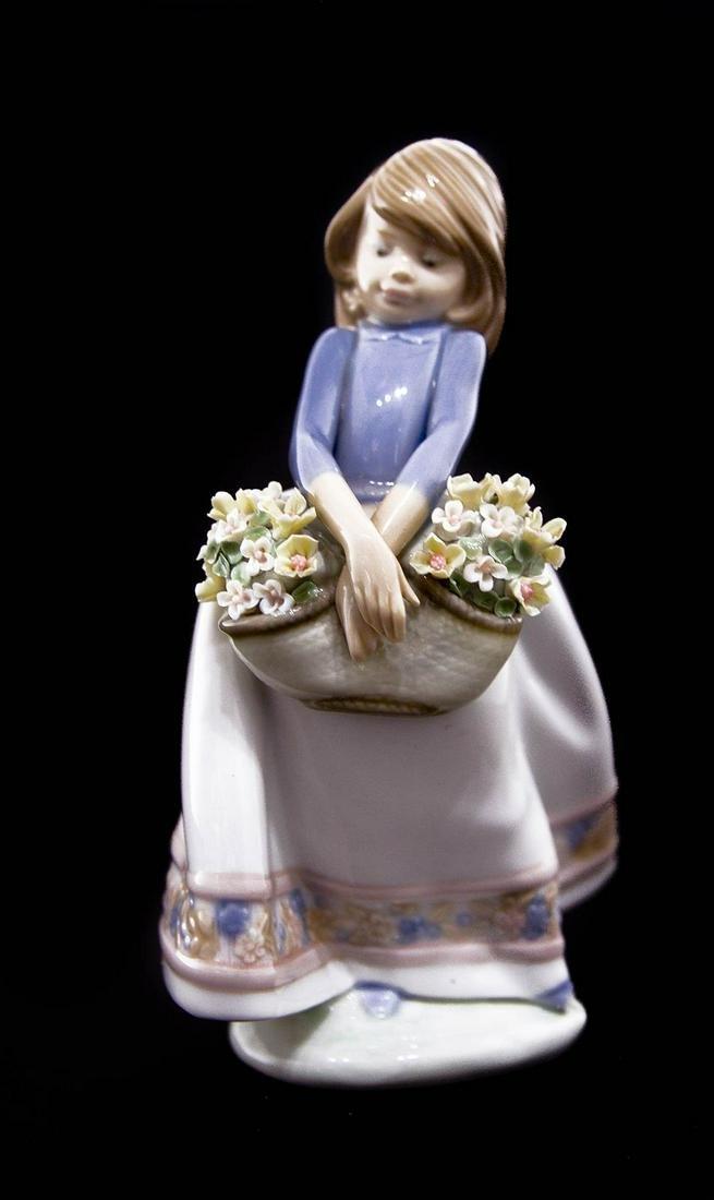 Lladro, Spain. Porcelain statuette. Little girl with