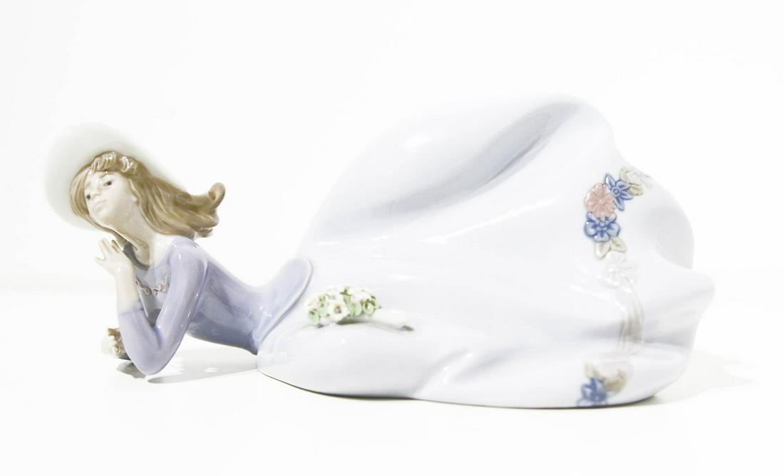 LLadro, Spain. Porcelain statuette. Laying woman. H cm
