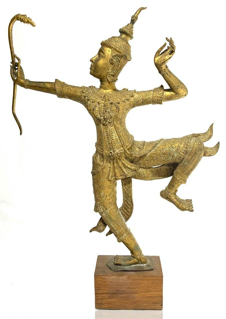 Origin Burma. Ancient statue in gilded bronze. Archer