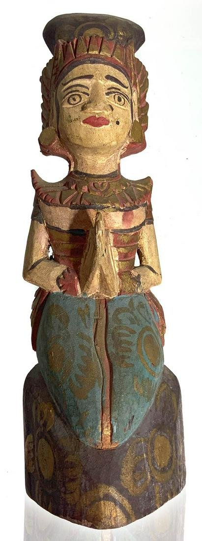 Bali Indonesian Origin. Statuette in colored wood.