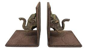 Pair of leather bookends with elephant head in gilded