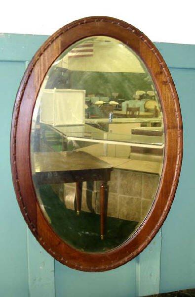707: A Good Victorian Oval Walnut Mirror