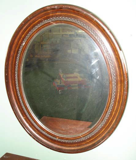 711: An Oval Victorian Mirror