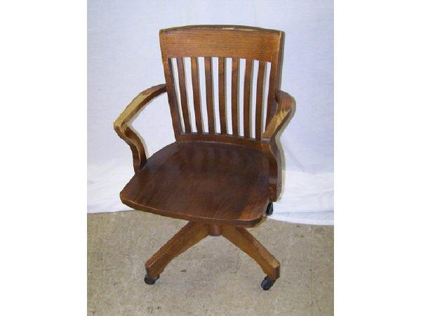556: Antique Oak Office Chair