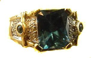 1003: 14K yg BLUE TOPAZ AND DIAMOND RING