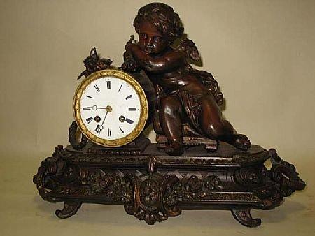 7004: Fine Antique Cherub Figural Clock