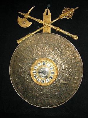 7196: Antique Tooled Bronze Shield Wall Clock
