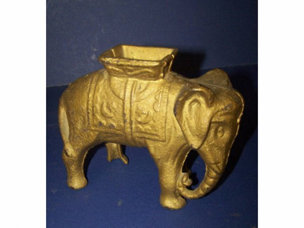 7: Antique Elephant Penny Bank