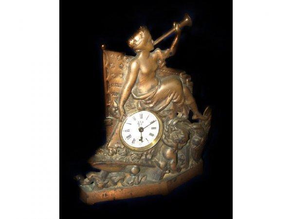 17: Cast Iron Figural Mantle Clock