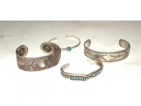 1251: Lot of 4 Sterling Indian Bracelets