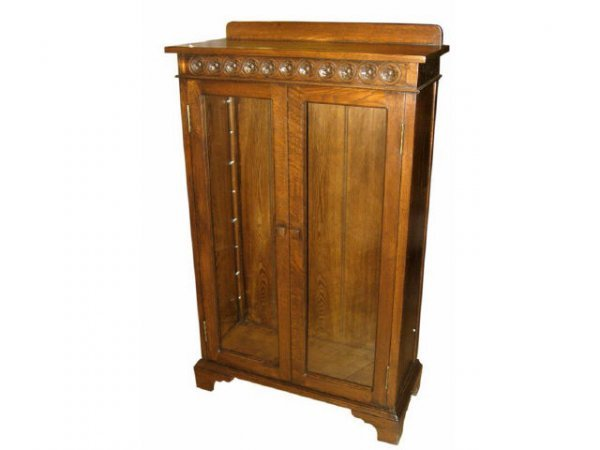 1309: Oak 2 Door Bookcase with Carving