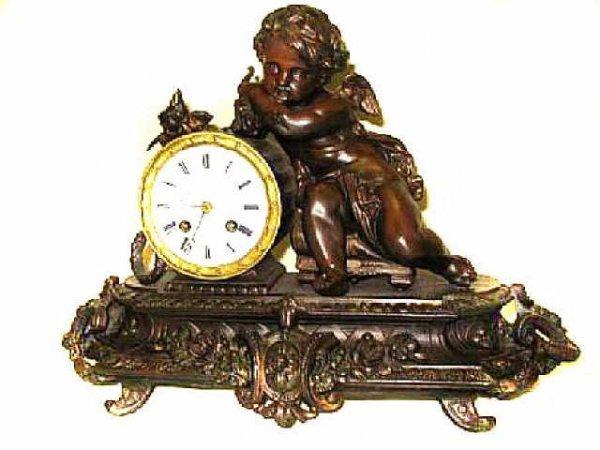 363: Winged Cherub Figural French Patinated Metal Clock