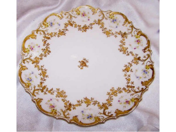 8221: large Limoges Decorated Charger