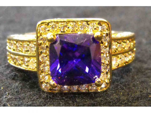 2007: Stamped 14k YG Ring with Amethyst Color Stone