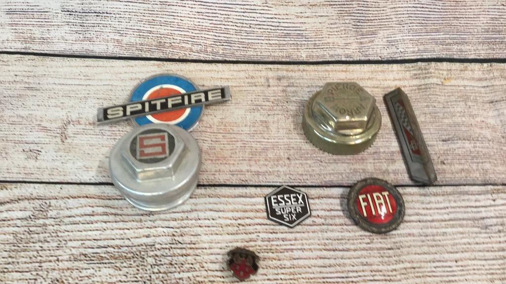 7 Vintage Automotive Center Caps & Badges