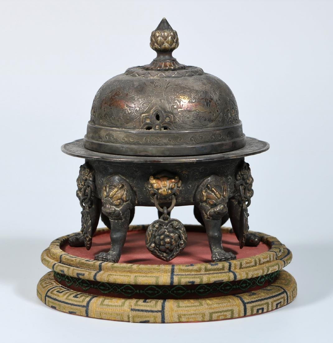 A Chinese Silver 'Mythical Beast' Incense Burner