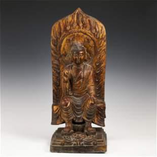 A LACQUER GILT WOOD FIGURE OF BUDDHA