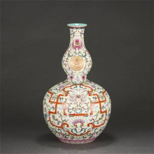 A FAMILLE ROSE FLORAL SCROLLS DOUBLE GOURDS VASE