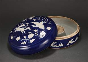 A BLUE GLAZED RESERVE DECORATED BOX WITH COVER