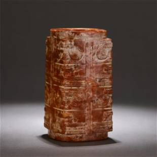A CARVED RUSSET JADE CONG