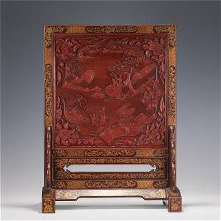 A CARVED CINNABAR LACQUER LANDSCAPE TABLE SCREEN