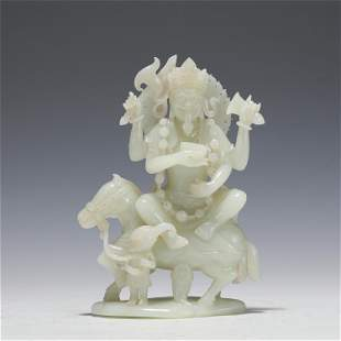 A CARVED WHITE JADE PROTECTOS