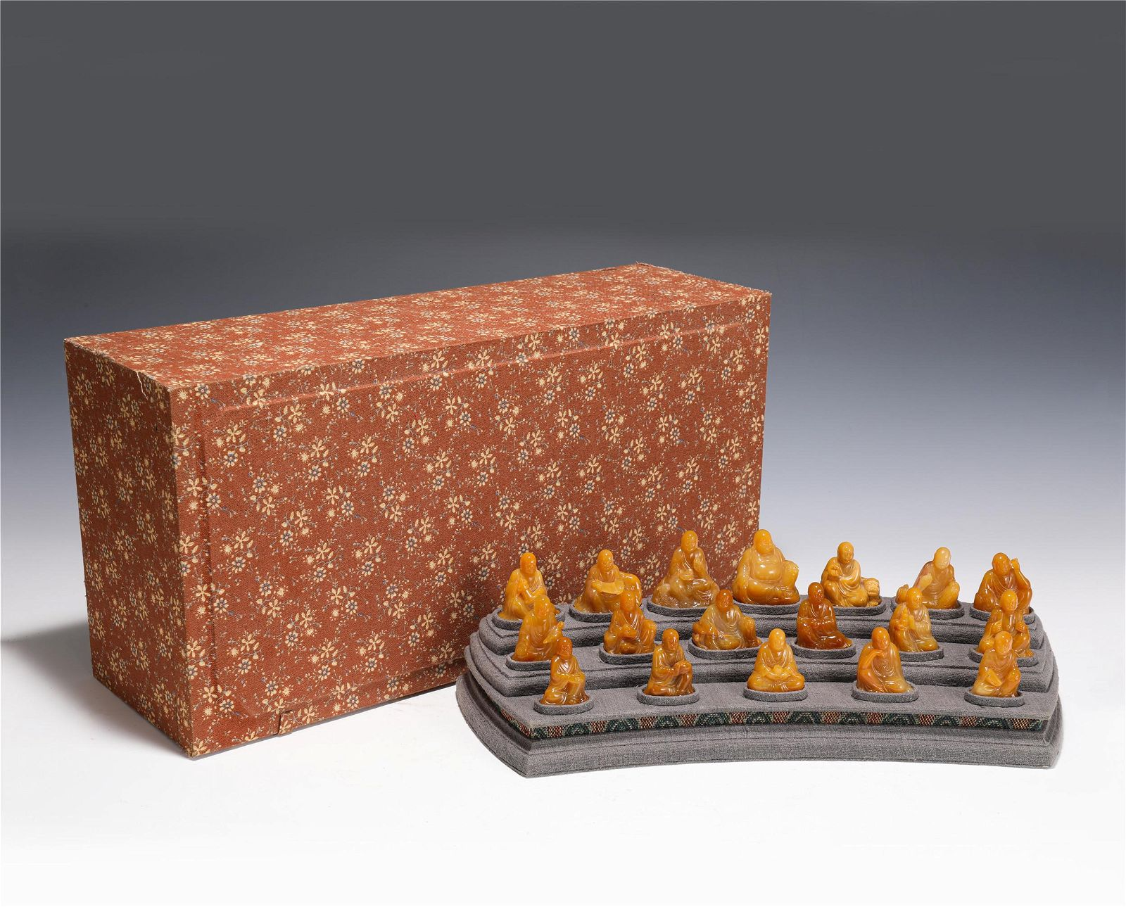 A SET OF CARVED TIANHUANG EIGHTEEN SEATED ARHATS