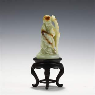 A CARVED STANDING FIGURE OF LONGEVITY