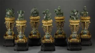 A SET OF SEVEN CARVED JASPER DECORATIONS