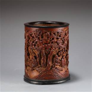 A CARVED BAMBOO FIGURAL BRUSHPOT