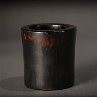 A CYLINDRICAL ROSEWOOD CUP