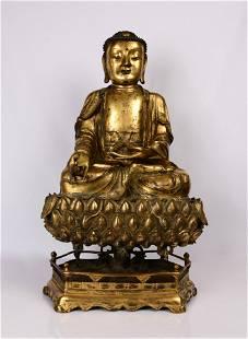 GILT BRONZE FIGURE OF SHAKYA MEDICINE BUDDHA