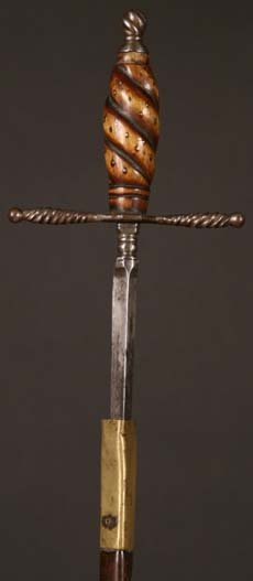 17: A 17th Century Left-handed Dagger with brass and le
