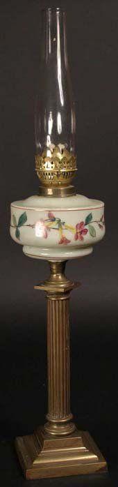 323: A Victorian Brass Oil Lamp; the pale eau-de-nil gl