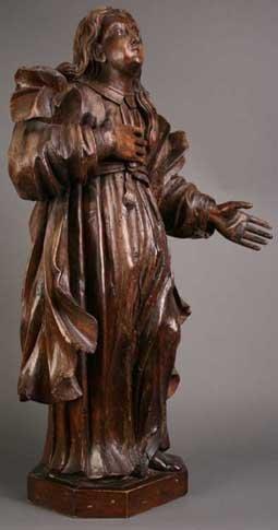 9: A 17th Century Carved Oak Figure of a Female Saint;