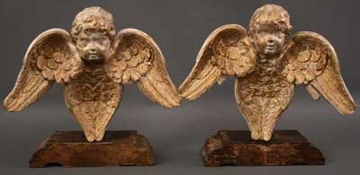 24: A Pair of 18th Century Carved and Gilded Cherub Hea