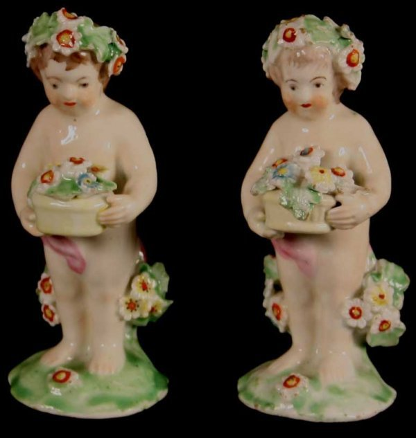 5: A Pair of Charming Derby Flower Putti bearing basket