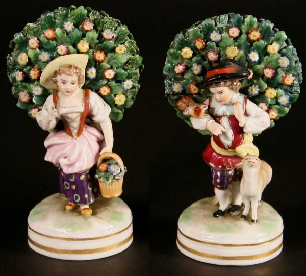 7: A Pair of Ornamental figures of a girl with basket o