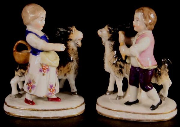 20: Two Pairs of Small Porcelain Figures of Children: a