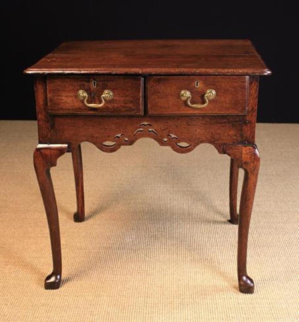 An Attractive 18th Century Oak Lowboy. The top having a