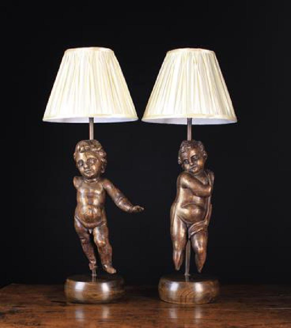 A Pair of Carved Oak Figural Lamps incorporating late