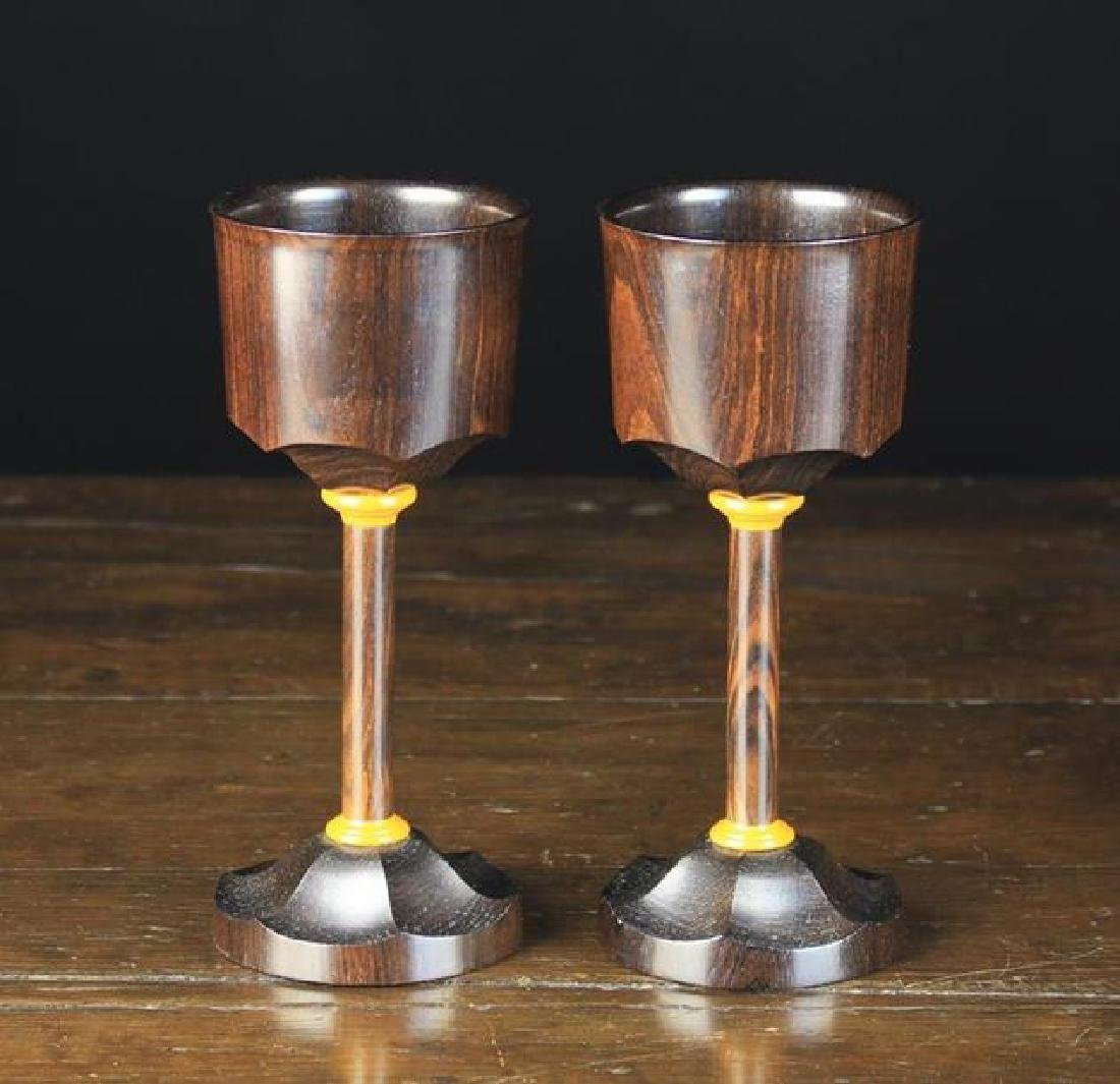 A Fine Pair of Modern Rosewood Goblets with bat-wing