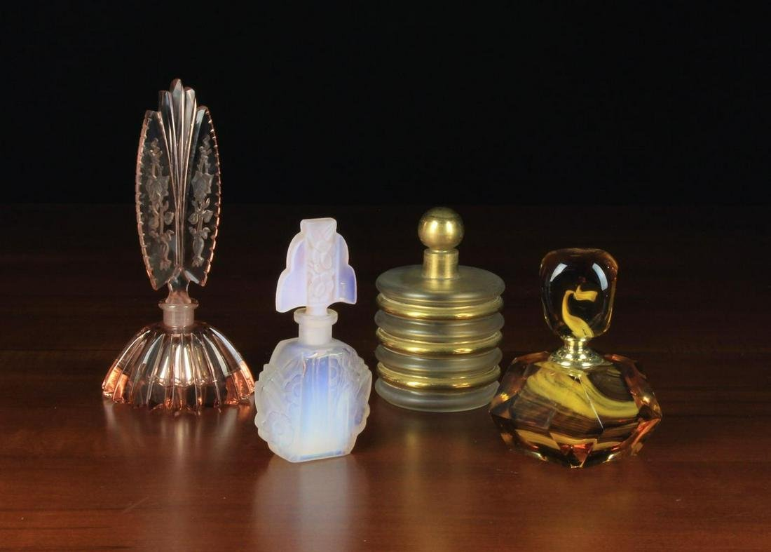 Four Art Deco Scent Bottles: The first of clear shell