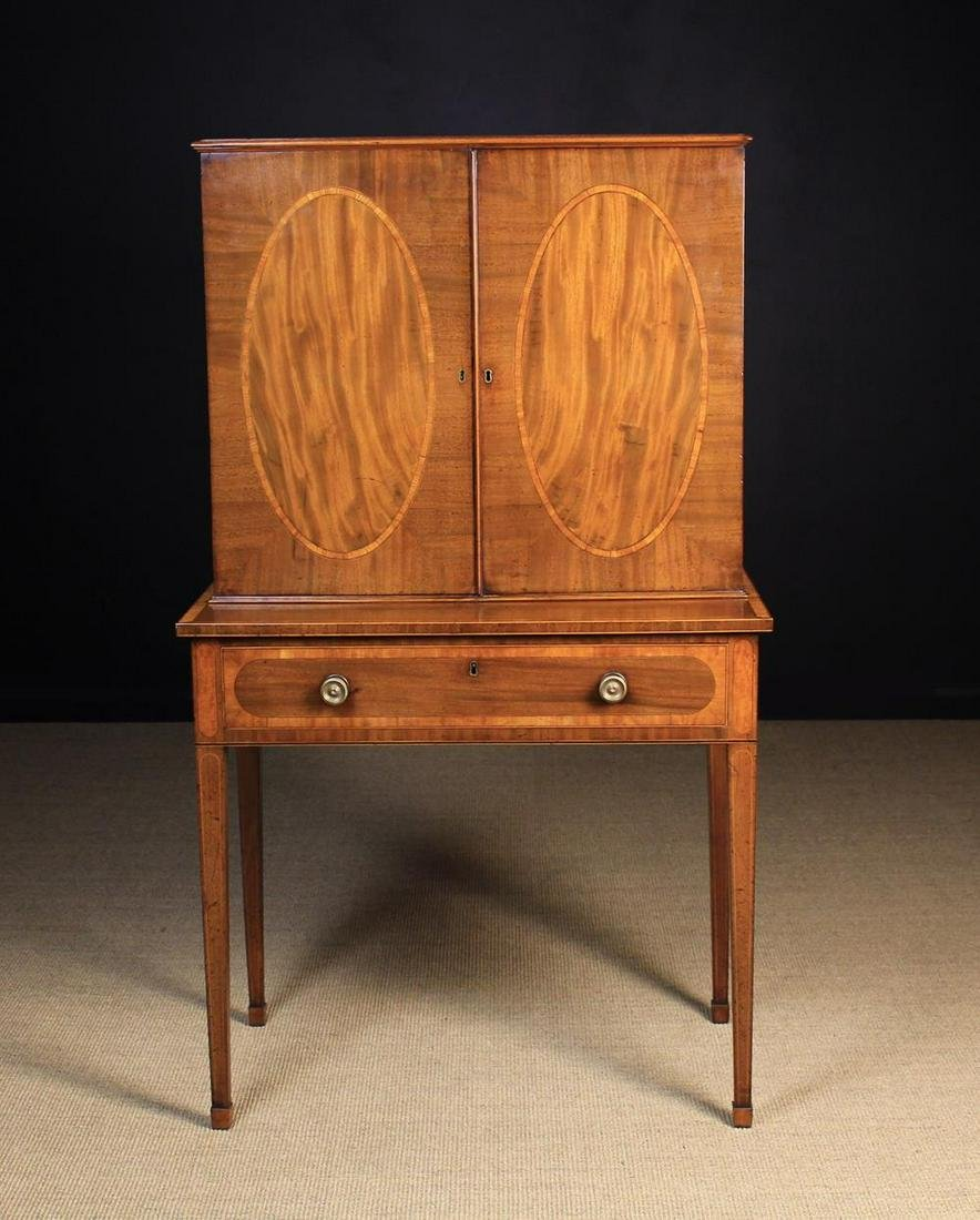 A Fine George III Mahogany Writing Desk with Bookcase